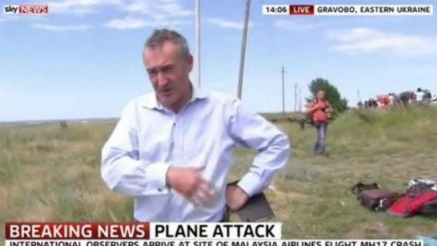 Sky reporter Colin Brazier at the crash site of MH17 in eastern Ukraine.