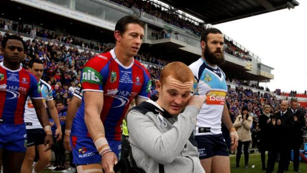 The real stories: an emotional Alex McKinnon is wheeled onto the Hunter Stadium turf on Sunday.