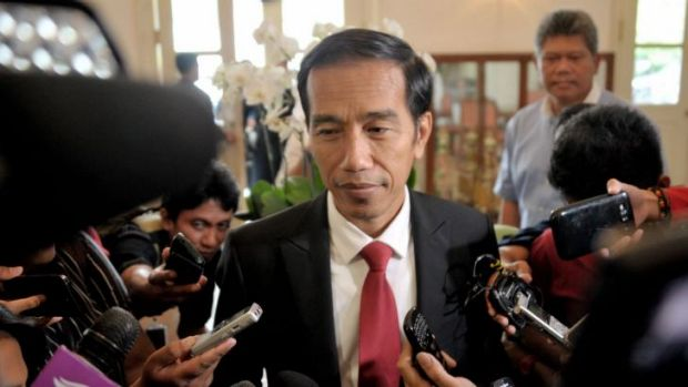 Back to work: President-elect Joko Widodo went back to his day job as Jakarta's Governor on Wednesday. He is due to be ...