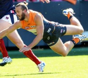 Down and out: GWS Giants defender Tim Mohr.