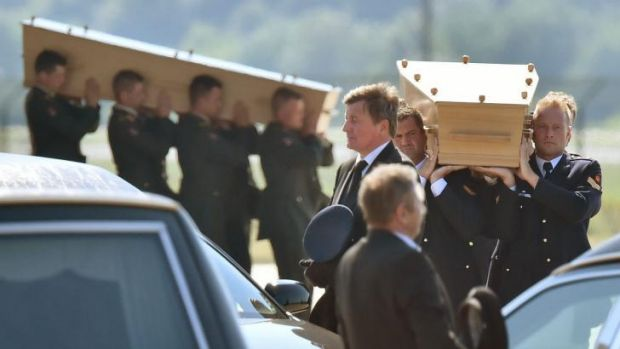 Dutch military men carry coffins containing the bodies of MH17 victims during a ceremony at Eindhoven Airbase after a ...