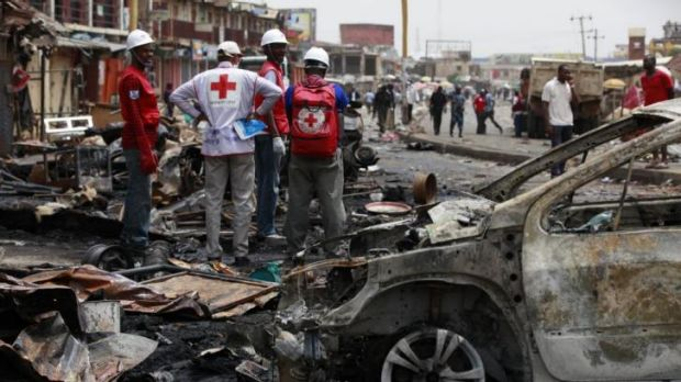 Earlier Boko Haram attack ... Red Cross personnel search for remains at the site of twin bomb explosions in Jos, ...