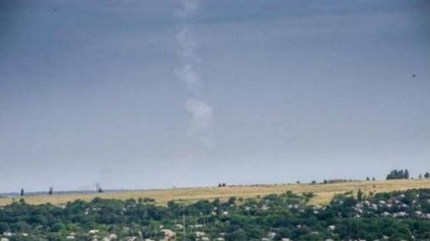 The trail of smoke left by a missile after it was fired by a the BUK-M1 system at MH17 by pro-Russia rebels, according ...