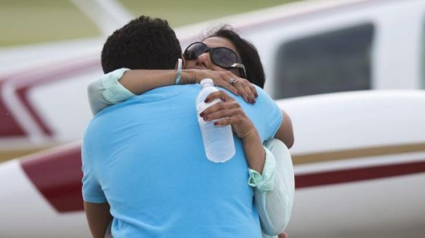 Haris Suleman hugs his mother, Shamim, before he and his father, Babar, took off in June on an ill-fated round-the-world ...