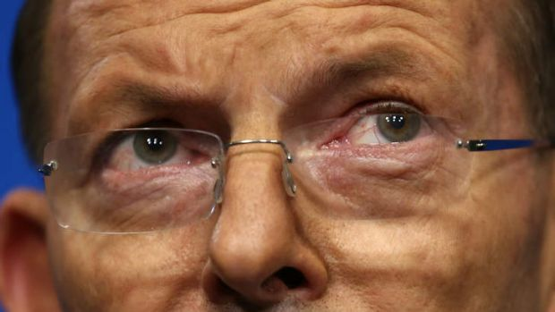 Prime Minister Tony Abbott's weary eyes betray the hours spent dealing with the disaster of flight MH17.