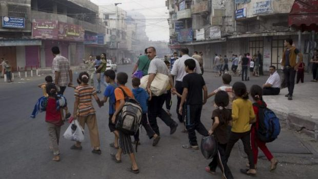 Residents flee the neighbourhood of Shujaiya during a brief ceasefire.