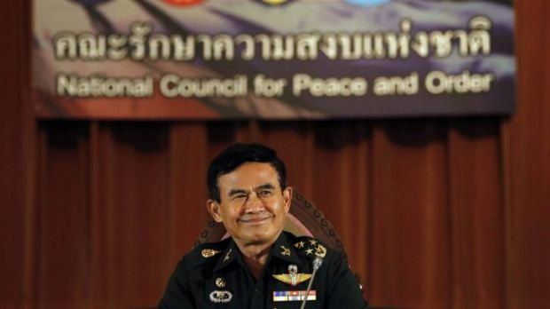 Deputy chief of Thailand's junta General Paiboon Koomchaya, announces the interim constitution.