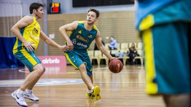 Matthew Dellavedova, right, is guarded by Damien Martin at the Australian Boomers training camp at the AIS on Thursday.