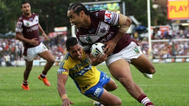 Club stalwart: Manly centre Steve Matai scores the match-winning try against Parramatta in March.