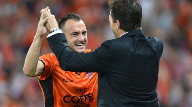 Roar power: Ivan Franjic celebrates with Mike Mulvey during the semi-final against Melbourne Victory in April.