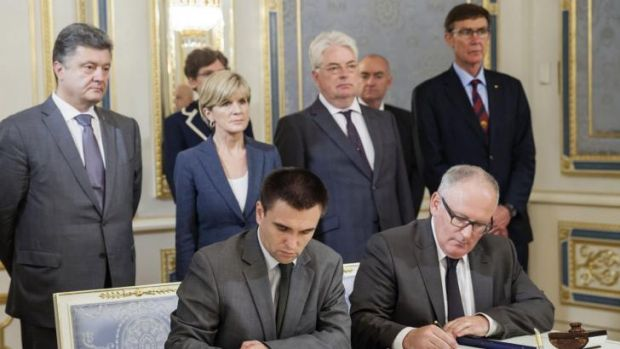 Dutch Foreign Minister Frans Timmermans (right, front) and Ukrainian Foreign Minister Pavlo Klimkin (left, front) sign ...