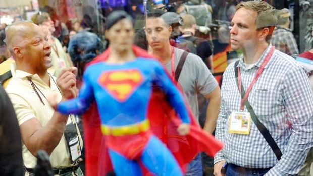 Super, man ... attendees debate the merits of a Superman figurine at Comic-Con 2014.