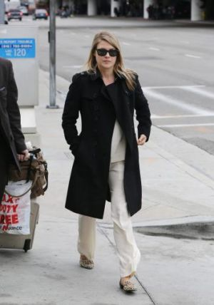 Effortless: Everyone should own a black trench like Ali Larter's.