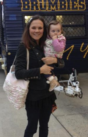 Louise McVerry with daughter Lucy at a Brumbies game in 2014.
