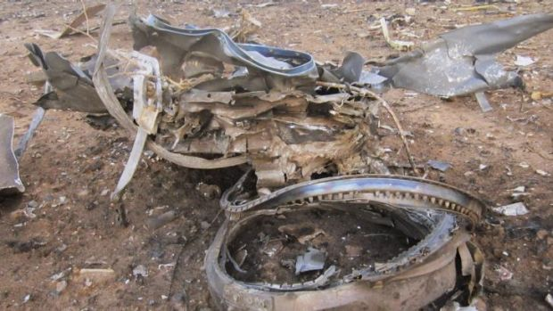 Debris is seen at the crash site of Air Algerie flight AH5017 near the northern Mali town of Gossi.