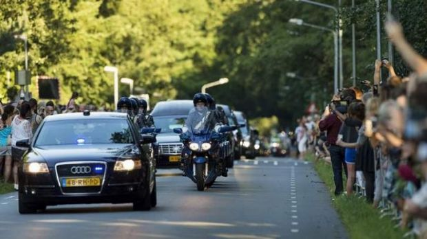 The Dutch have lined the streets to observe the hearses carrying the remains of MH17 victims and pay their respects.