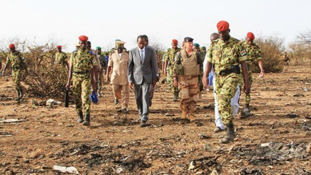 Burkina Faso's President Blaise Compaore, centre, visits the crash site.