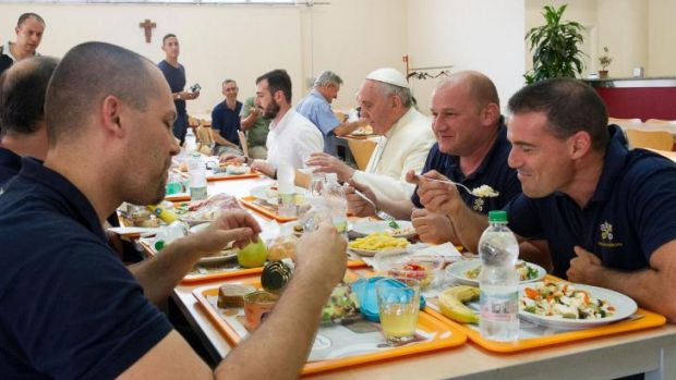 The Pope sits down with Vatican workers in the staff canteen.