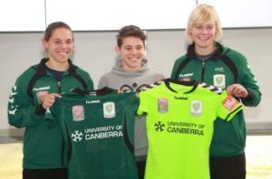 Canberra United players show off their new playing strip, fluoro green. Players l-r Nicole Begg, Ashleigh Sykes, ...
