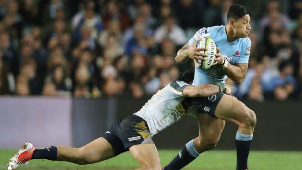 On the loose: Waratahs fullback Israel Folau tries to make a break against the Brumbies.