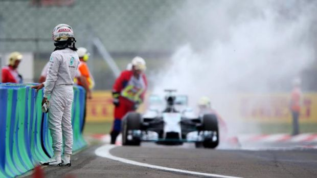 Lewis Hamilton watches his pole position go up in smoke.