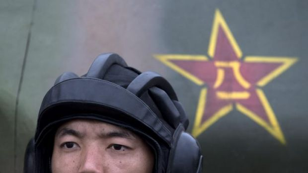 Show of strength: A Chinese People's Liberation Army cadet sits in a Main Battle Tank during a demonstration of military ...