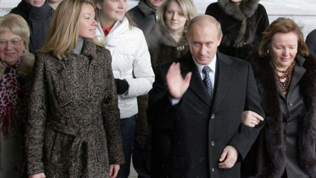 Vladimir Putin with his daughter Maria, left, and then wife Ludmilla, in 2007.