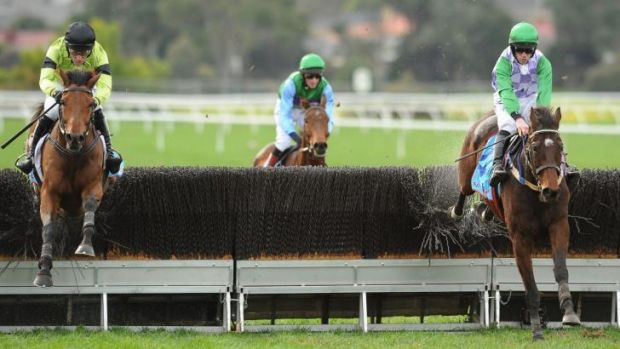 John Allen riding Wells (right) in the Grand National Steeplechase.