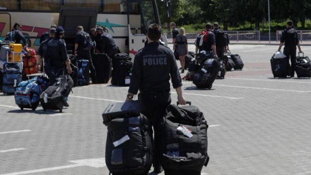 Members of the Australian police mission arrive at Kharkiv airport en route to the crash site.