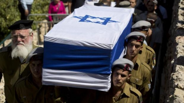 Israeli soldiers carry the coffin of Staff Sgt. Amit Yeori, 20, during his funeral at the Mount Herzel military cemetery ...