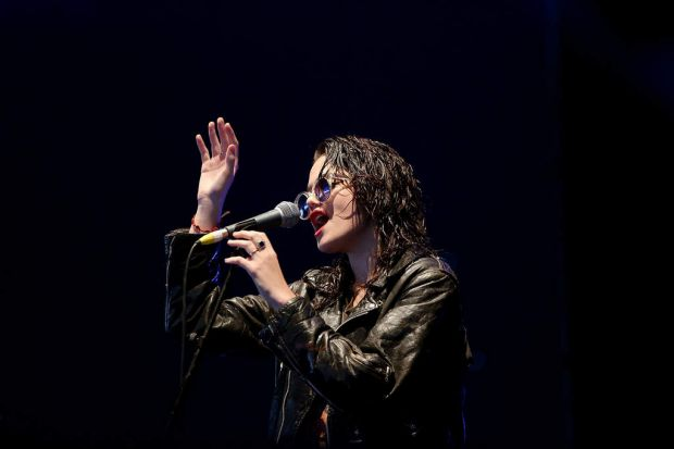 A dark-haired Sky Ferreira performs at Splendour In The Grass.