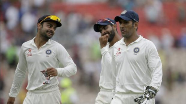India captain and wicketkeeper Mahendra Singh Dhoni, right.