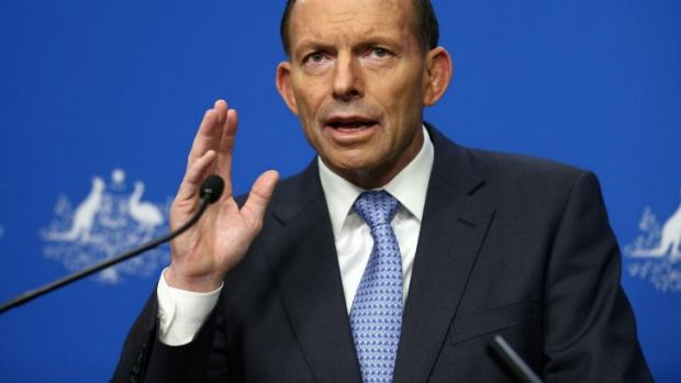 Prime Minister Tony Abbott addresses the media on Malaysia Airlines flight MH17 during a press conference.
