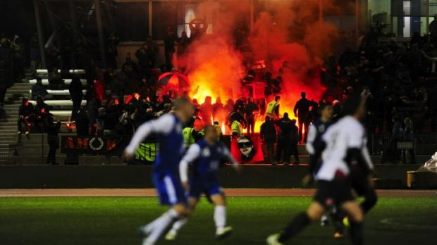 Wanderers supporters light flares into the crowd during a match against Canberra Olympic at the AIS last year..