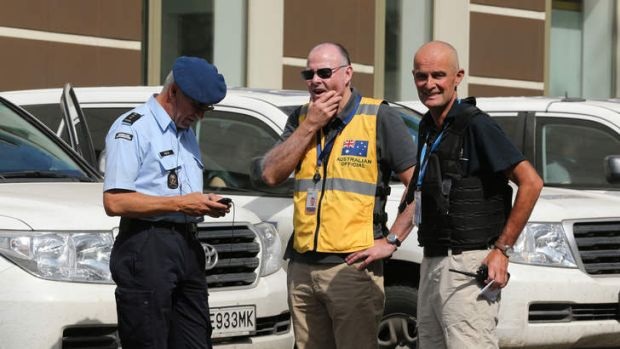 Brian McDonald (centre) of the Australian Federal Police contingent with a Dutch colleague (left) and OSCE member ...