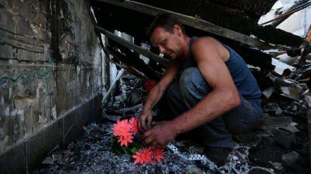 Dimitriy Gorozhaninov mourns for four members of his family, who died in a Ukrainian artillery barrage in Petrovskiy.