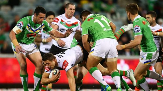 No serious damage: Sam Burgess falls awkwardly on his right shoulder during Souths' win over the Raiders on Monday.