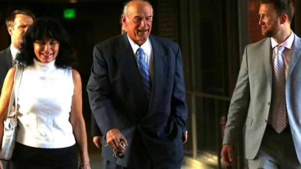 Former Minnesota Governor Jesse Ventura, centre, arrives at court with his wife, Terry, and others for the defamation case.