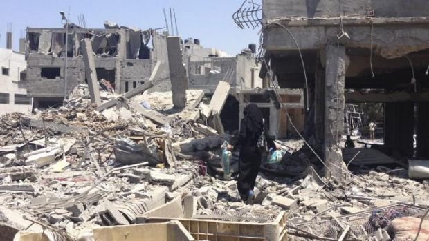 Nissana Sukar in the rubble outside her home in Shujaiyah.