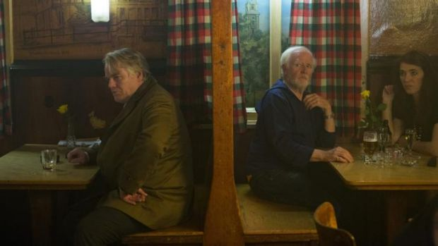 Strong: Philip Seymour Hoffman stars as Gunter Bachmann in <i>A Most Wanted Man</i> and writer John Le Carre (right) has ...