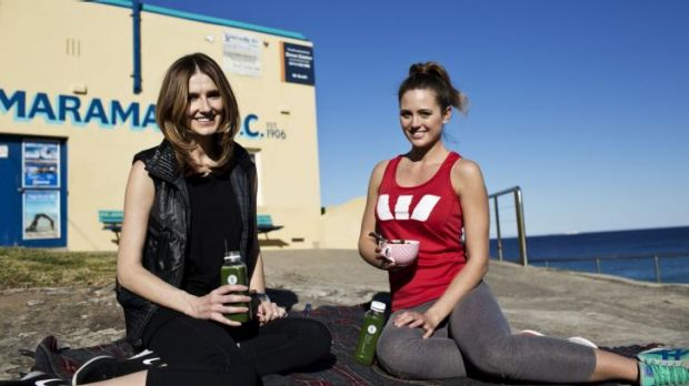 Picnic time: Jesinta Campbell, right, and Kate Waterhouse have a picnic outside Tamarama Beach Surf Club.