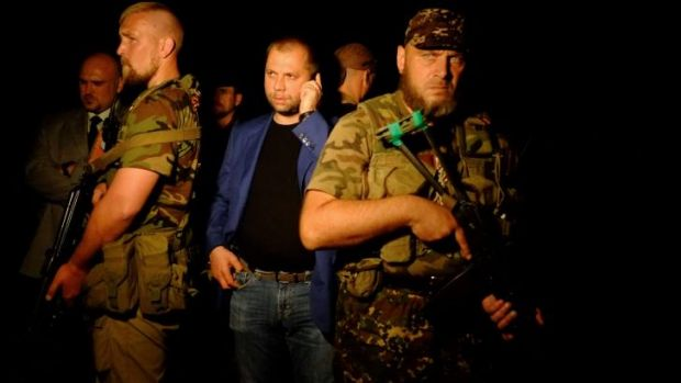 Alexander Borodai (centre) at the MH17 crash site. He has been reportedly recalled to Moscow.