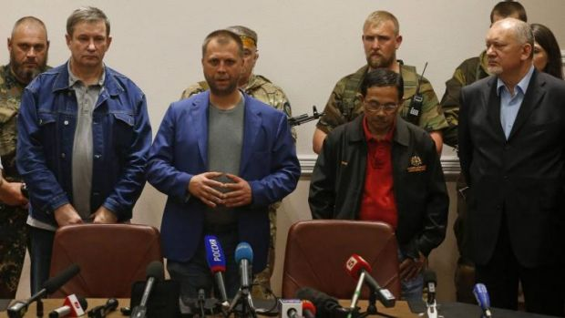 Vladimir Antyufeev (right) at the press conference where the MH17 black boxes were handed to Malaysia, with Alexander ...