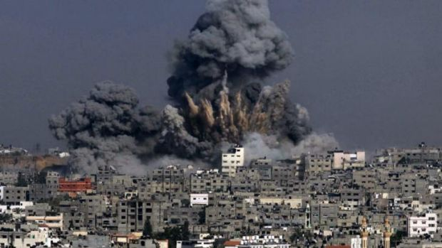 Heavy smoke billows after an Israeli military strike in Gaza City.