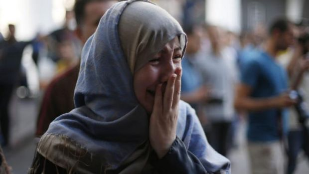 A Palestinian mourns at a hospital in Gaza City after an Israeli strike on a packed market.