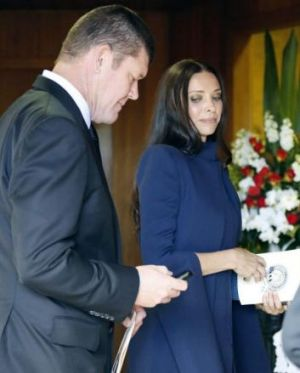 James Packer and Erica Baxter arrive for Paul Ramsay's funeral.