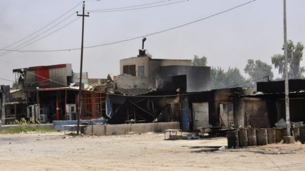 Burnt-out shops after clashes between Iraqi security forces and ISIL militants in Baquba.