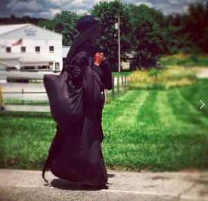 The woman in black trudges through Kentucky