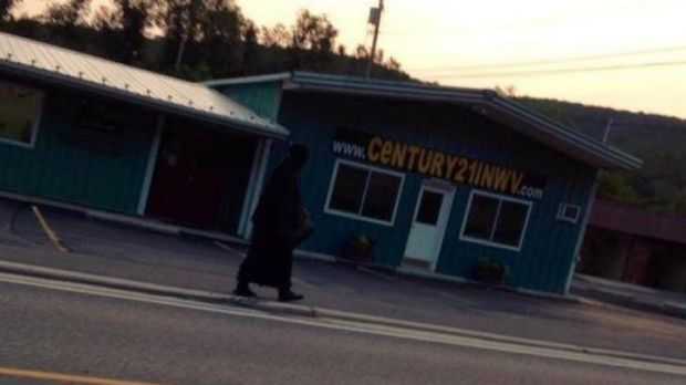 The woman in black walking through Tennessee.