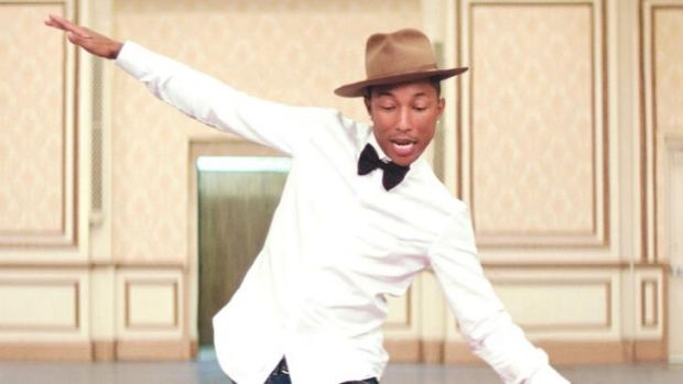 Happy ... Pharrell Williams loves the work of the folks from the Diana Isaac Retirement Village.